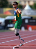 Alan Fonteles Oliveira of Brazil reacts after winning the Men's 200m T43 final during day two of the IPC Athletics World Championships on July 21...