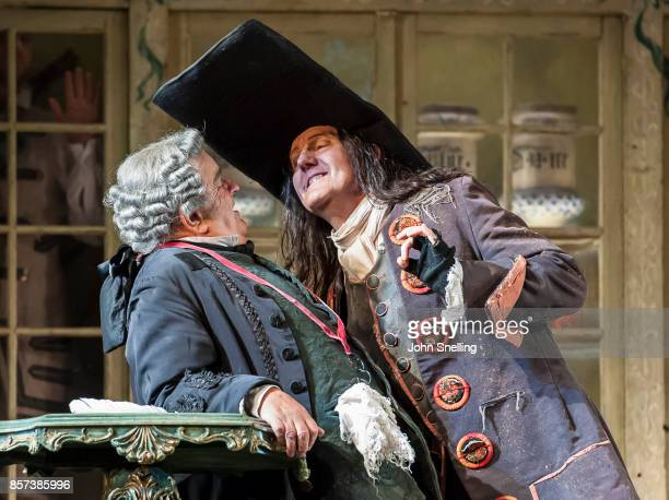Alan Opie as Bartola and Alastair Miles as Basilio perform on stage during a performance of Jonathan Millers classic production of 'The Barber of...