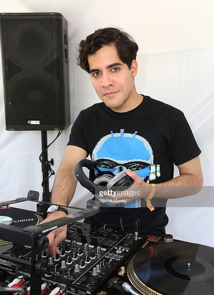 Alan Palomo of Neon Indian DJ set during NYLON x BOSS ORANGE Escape House - Day 2 at Lake La Quinta Inn on April 14, 2013 in La Quinta, California.