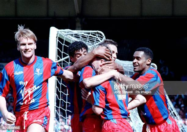 Alan Pardew is mobbed by teammates after he scored the dramatic fourth goal for Crystal Palace in the FA Cup SemiFinal against holders Liverpool at...