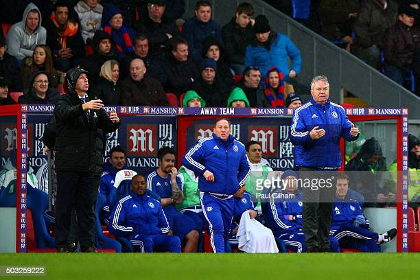Alan Pardew manager of Crystal Palace and Guus Hiddink manager of Chelsea issue instructions to their players during the Barclays Premier League...