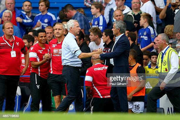 Alan Pardew Manager of Crystal Palace and Head coach Jose Mourinho of Chelsea shake hands after the Barclays Premier League match between Chelsea and...