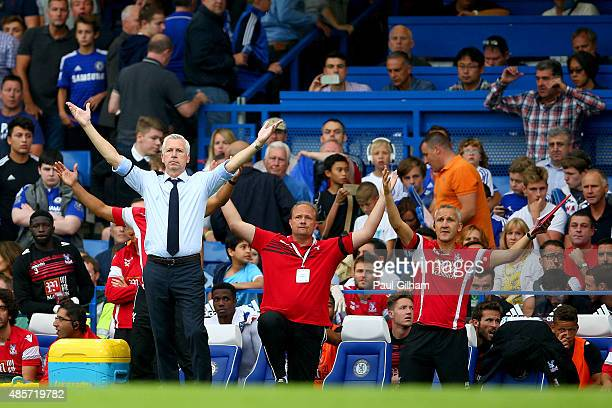 Alan Pardew Manager of Crystal Palace and team staffs celebrate their team's 21 win in the Barclays Premier League match between Chelsea and Crystal...