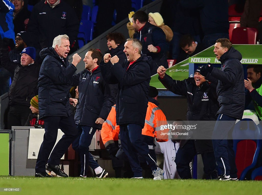 Alan Pardew manager of Crystal Palace (L) celebrates a goal with the bench during the Barclays Premier League match between Crystal Palace and Tottenham Hotspur at Selhurst Park on January 10, 2015 in London, England.