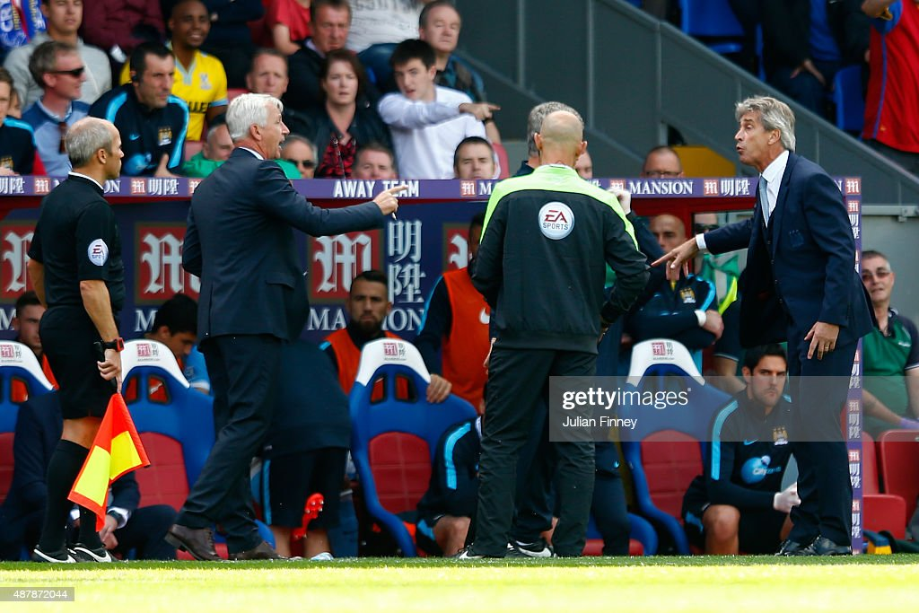 Alan Pardew, manager of Crystal Palace exchanges words with Manuel Pellegrini, manager of Manchester City during the Barclays Premier League match between Crystal Palace and Manchester City at Selhurst Park on September 12, 2015 in London, United Kingdom.