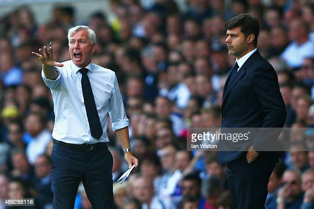 Alan Pardew manager of Crystal Palace gives instructions as Mauricio Pochettino manager of Tottenham Hotspur looks on during the Barclays Premier...