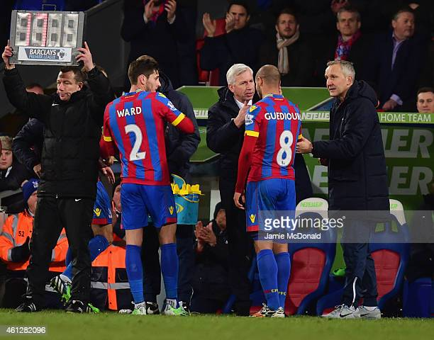 Alan Pardew manager of Crystal Palace gives instructions to Adlene Guedioura of Crystal Palace during the Barclays Premier League match between...