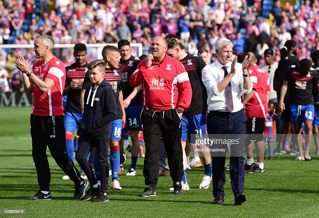 Alan Pardew, manager of Crystal Palace leads the Crystal Palace players and staff on a lap of appreciation after the Barclays Premier League match between Crystal Palace and Stoke City at Selhurst Park on May 7, 2016 in London, England.