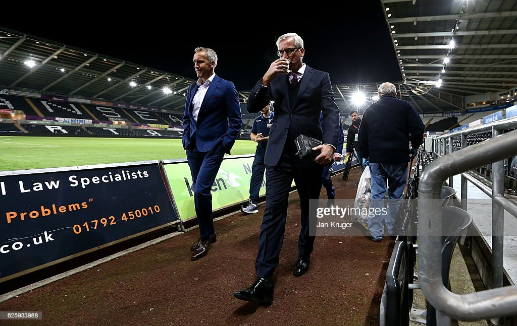 Alan Pardew, manager of Crystal Palace leaves the stadium after the final whistle during the Premier League match between Swansea City and Crystal Palace at Liberty Stadium on November 26, 2016 in Swansea, Wales.