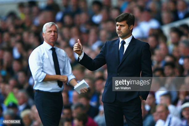 Alan Pardew manager of Crystal Palace looks on as Mauricio Pochettino manager of Tottenham Hotspur gives the thumbs up during the Barclays Premier...