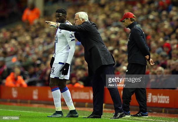 Alan Pardew Manager of Crystal Palace talks to Bakary Sako of Crystal Palace during the Barclays Premier League match between Liverpool and Crystal...
