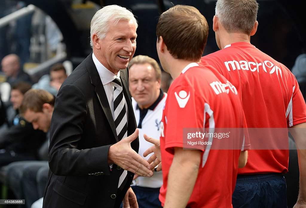 Alan Pardew (L) manager of Newcastle United greets Crystal Palace staff ahead of the Barclays Premier League match between Newcastle United and Crystal Palace at St James' Park on August 30, 2014 in Newcastle upon Tyne, England.