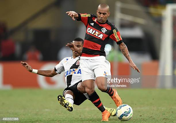 Alan Patrick of Flamengo battles for the ball with Rafael Vaz of Vasco during a match between Flamengo and Vasco as part of Brasileirao Series A 2015...