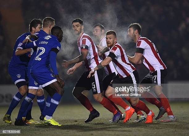 Alan Power Luke Waterfall an Jamie McCombe of Lincoln City prepare for a corner during the Emirates FA Cup Second Round match between Lincoln City...