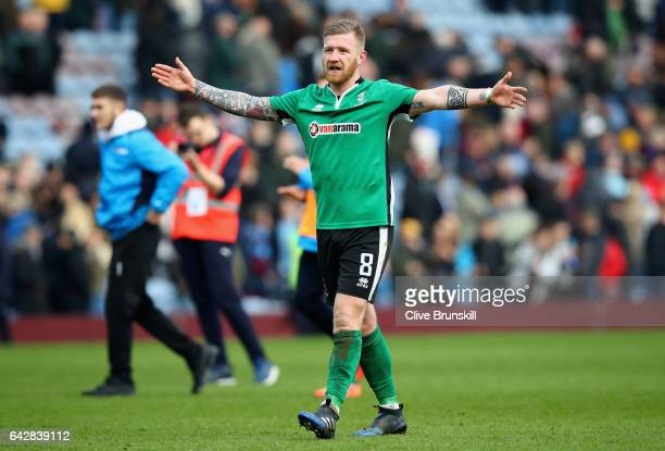Alan Power of Lincoln City celebrates after the final whistle during The Emirates FA Cup Fifth Round match between Burnley and Lincoln City at Turf...