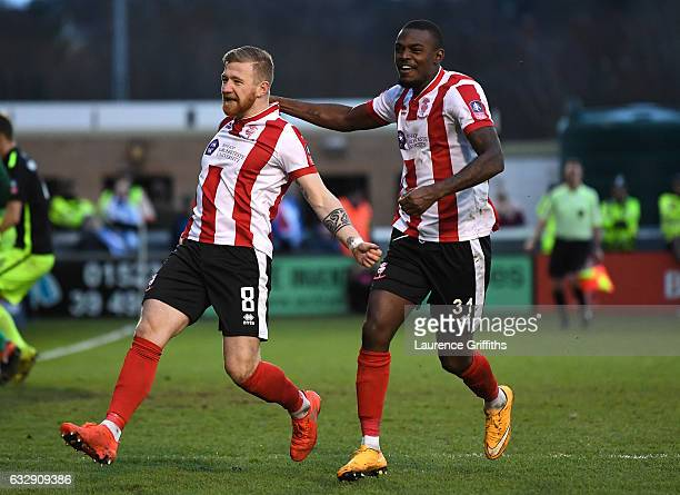 Alan Power of Lincoln City celebrates scoring the opening goal with his team mate Theo Robinson during the Emirates FA Cup Fourth Round match between...