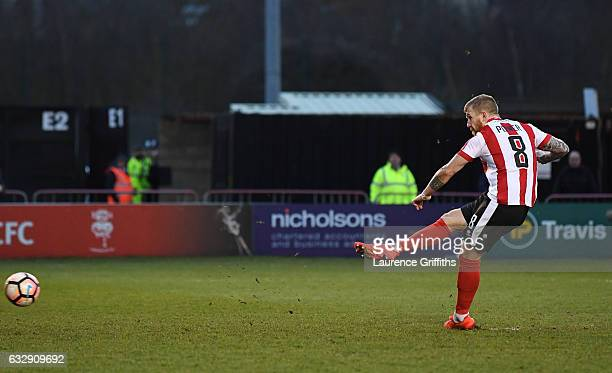 Alan Power of Lincoln City converts the penalty to score the opening goal during the Emirates FA Cup Fourth Round match between Lincoln City and...