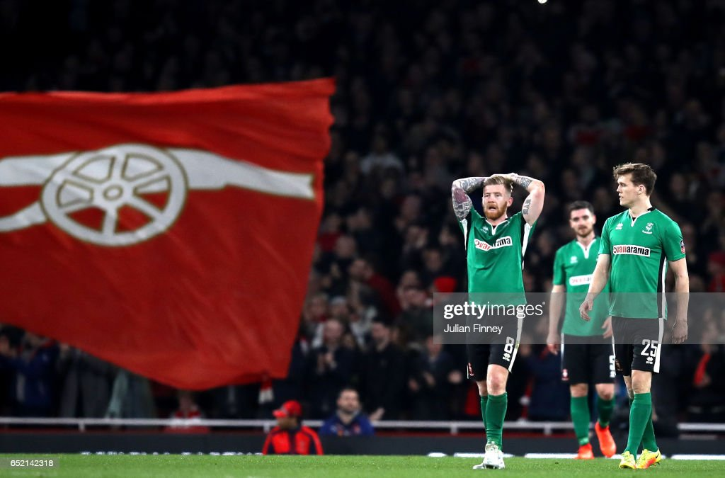 Alan Power of Lincoln City reacts to Arsneal scoring their fourth goal during The Emirates FA Cup Quarter-Final match between Arsenal and Lincoln City at Emirates Stadium on March 11, 2017 in London, England.