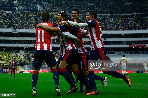 Alan Pulido of Chivas celebrates after scoring the first goal of his team during the semifinal match between America and Chivas as part of the Copa...