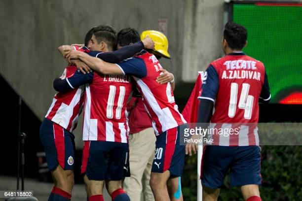 Alan Pulido of Chivas celebrates with teammates after scoring his team's first goal during the 9th round match between Chivas and Toluca as part of...