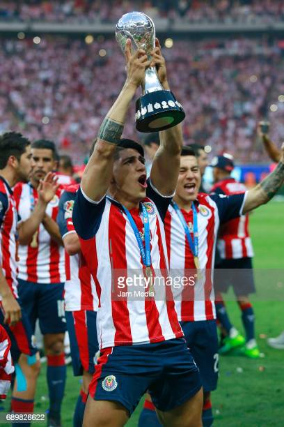 Alan Pulido of Chivas celebrates with the champions trophy after winning the Final second leg match between Chivas and Tigres UANL as part of the...