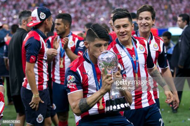 Alan Pulido of Chivas lifts the champions trophy after winning the Final second leg match between Chivas and Tigres UANL as part of the Torneo...