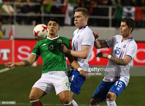 Alan Pulido of Mexico controls the ball against Orri Sigurdur Omarsson and Vidar Ari Jonsson of Iceland during their exhibition match at Sam Boyd...