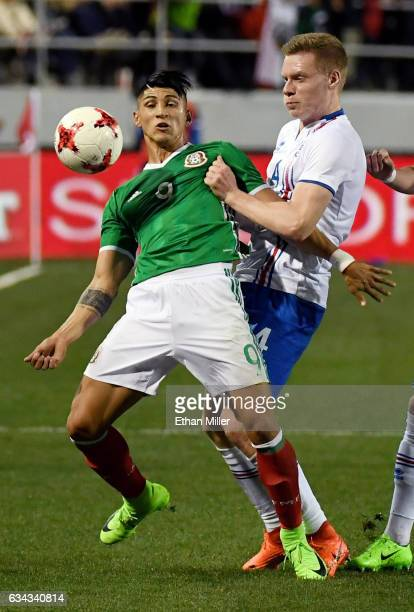Alan Pulido of Mexico controls the ball against Orri Sigurdur Omarsson of Iceland during their exhibition match at Sam Boyd Stadium on February 8...