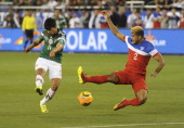 Alan Pulido of Mexico fires a shot past DeAndre Yedlin of USA during a friendly match between USA and Mexico previous to the FIFA World Cup Brazil...