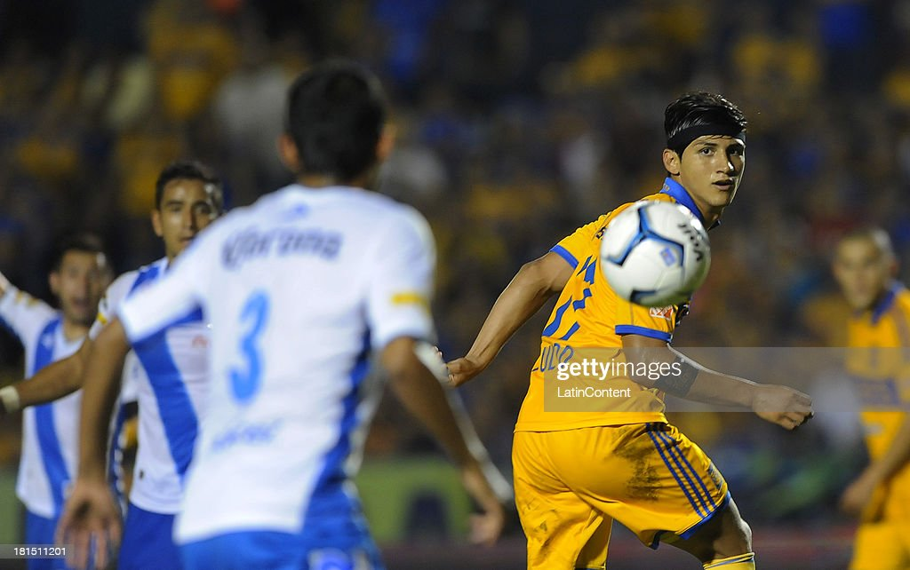 <a gi-track='captionPersonalityLinkClicked' href=/galleries/search?phrase=Alan+Pulido&family=editorial&specificpeople=5933954 ng-click='$event.stopPropagation()'>Alan Pulido</a> of Tigres in action during a match between Tigres UANL and Puebla FC as part of the Liga MX at Universitario stadium on September 21, 2013 in Monterrey, Mexico.
