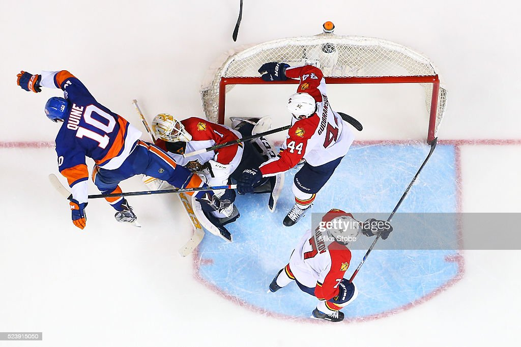 Alan Quine #10 of the New York Islanders collides with Roberto Luongo #1 of the Florida Panthers in Game Six of the Eastern Conference First Round during the NHL 2016 Stanley Cup Playoffs at the Barclays Center on April 24, 2016 in Brooklyn borough of New York City.