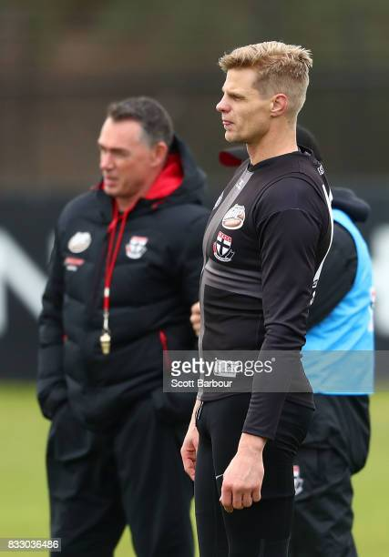 Alan Richardson coach of the Saints and Nick Riewoldt of the Saints look on the ball during a St Kilda Saints AFL training session at Linen House...