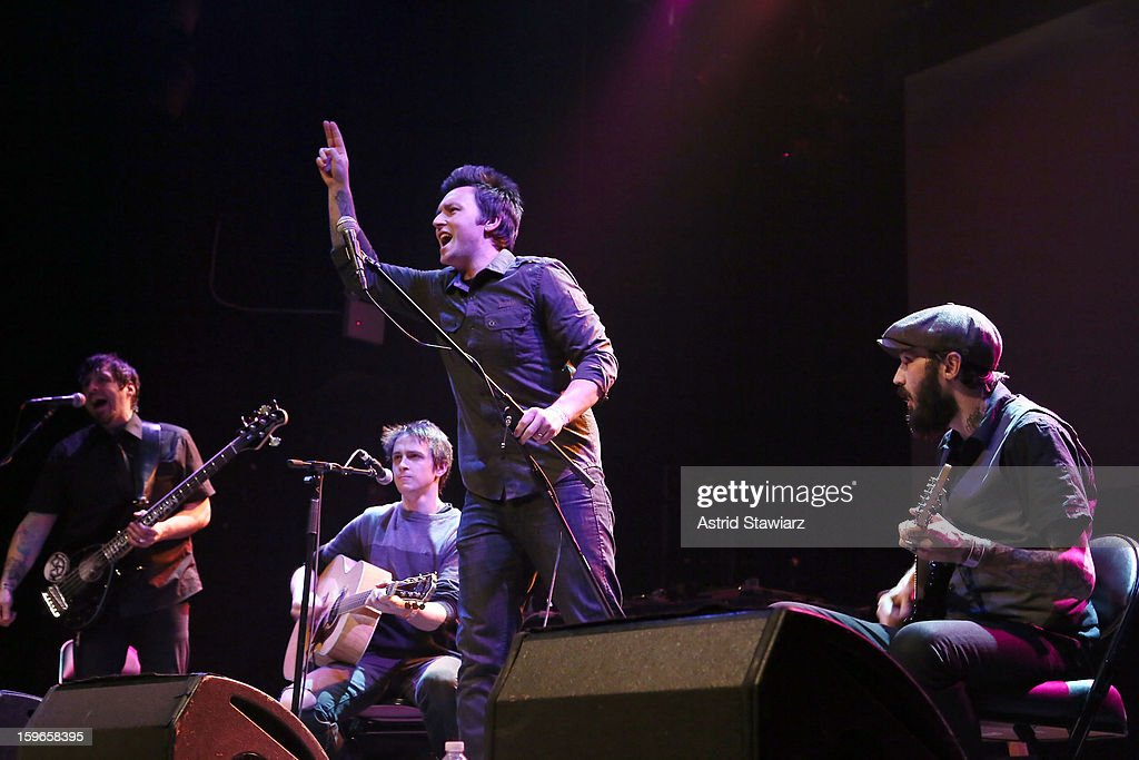 Alan Riches, Brett Haggarty, Adam Haggarty and Tom Gardner of Beyond The Curtain perform during the Rock For Recovery, A Benefit For Victims Of Hurricane Sandy at the Gramercy Theatre on January 17, 2013 in New York City.