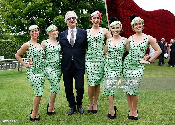 Alan Rickman poses with 'Elle The Pocket Belles' as he attends on day two of the Qatar Goodwood Festival at Goodwood Racecourse on July 29 2015 in...