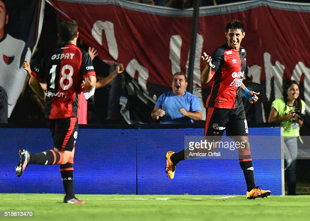 Alan Ruiz of Colon celebrates with teammate Ezequiel Sperduti after scoring during a match between Colon and River Plate as part of Torneo de...