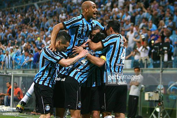 Alan Ruiz of Gremio celebrates their first goal during the match Gremio v Sport as part of Brasileirao Series A 2014 at Arena do Gremio on October 08...