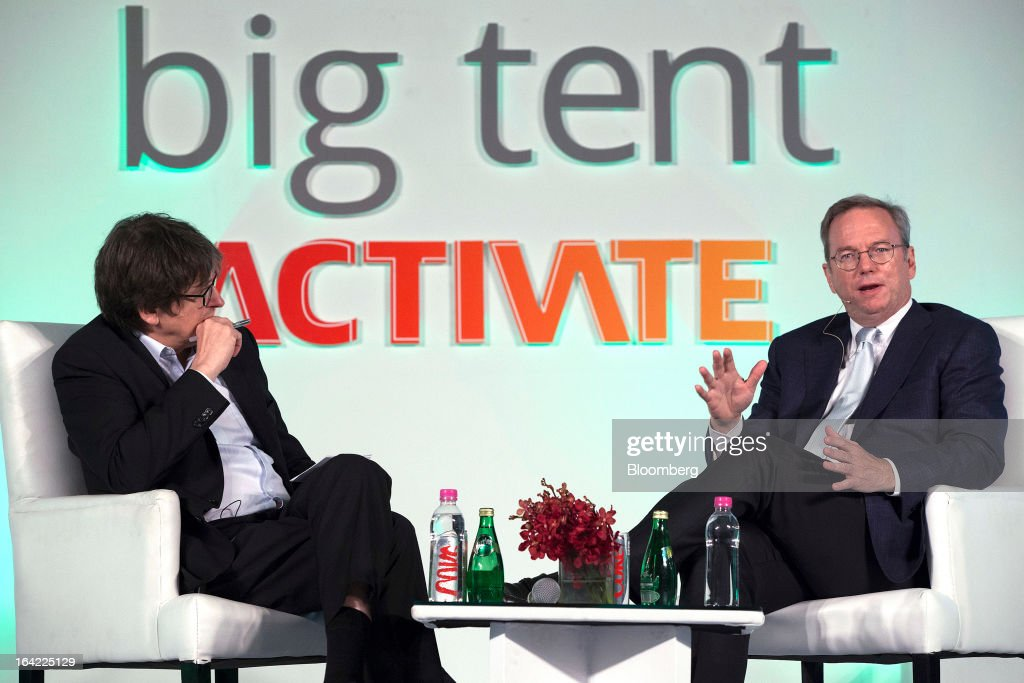 Alan Rusbridger, editor-in-chief of Guardian News and Media Ltd., left, listens whilst Eric Schmidt, executive chairman of Google Inc., speaks during the Big Tent Activate Summit in New Delhi, India, on Thursday, March 21, 2013. Schmidt says it is very important that the Indian government respects the right to privacy as the internet grows. Photographer: Prashanth Vishwanathan/Bloomberg via Getty Images