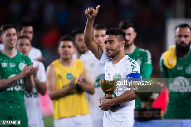 Alan Ruschel of Chapecoense holds the second place trophy after the Joan Gamper Trophy match between FC Barcelona and Chapecoense at Camp Nou stadium...