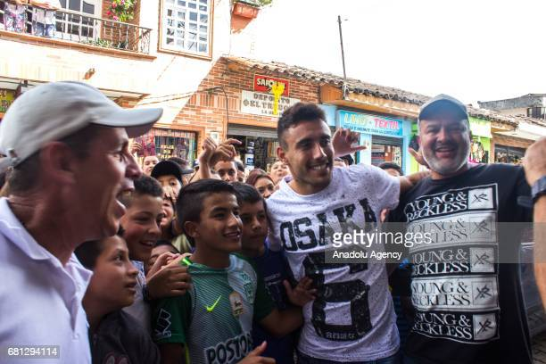 Alan Ruschel one of the survivors of the Chapecoense team pose for a photo with fans as people pay tribute to the players of Brazilian team...