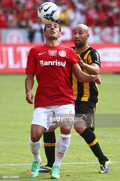 Alan Ruschel player of Brazilian Internacional and Baltazar Silva player of Uruguayan Penarol vie during a friendly match held to inaugurate the...