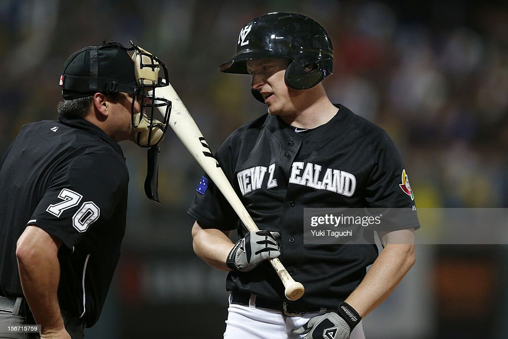 Alan Schoenberger #38 of Team New Zealand argues a called strike with home plate umpire D.J. Reyburn #70 during Game 6 of the 2013 World Baseball Classic Qualifier against Team Chinese Taipei at Xinzhuang Stadium in New Taipei City, Taiwan on Sunday, November 18, 2012.