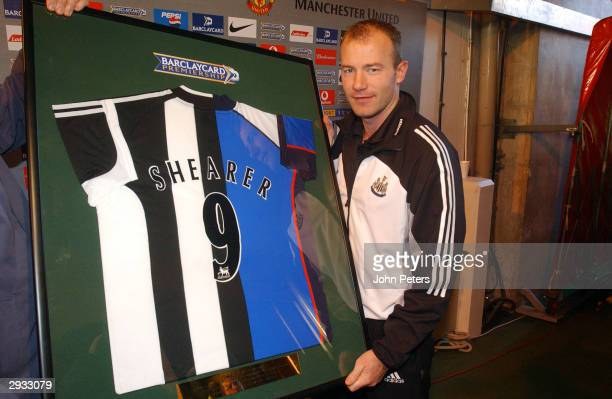 Alan Shearer is presented with a Newcastle and Blackburn shirt after the FA Barclaycard Premiership match between Manchester United v Newcastle at...
