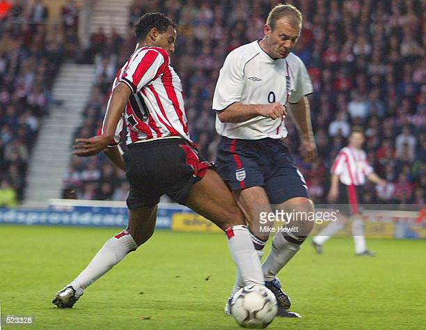 Alan Shearer of England XI is challenged by Tahar El Khalej of Southampton during the Matt Le Tissier Testimonial match played between Southampton...