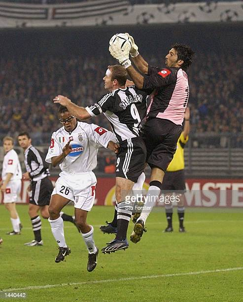 Alan Shearer of Newcastle United and Gianluigi Buffon of Juventus in action during the UEFA Champions League Group E match between Juventus and...