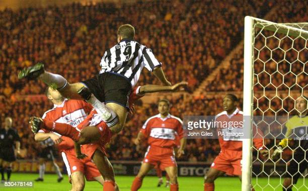 LEAGUE Alan Shearer of Newcastle United rises above the Middlesbrough defence as he waits for a cross during their FA Premiership football match at...