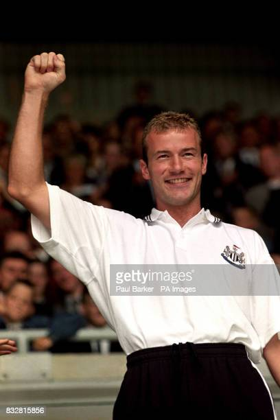 Alan Shearer salutes the fans of Newcastle United after he was officially introduced as their new signing during the welcoming ceremony at St James's...