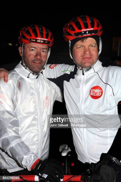 Alan Shearer the former England footballer and Adrian Chiles the TV sport presenter before they ride into the BBC TV centreafter riding bikes from...