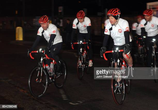 Alan Shearer the former England footballer and Adrian Chiles the TV sport presenter ride into the BBC TV centre after riding bikes from Newcastle to...