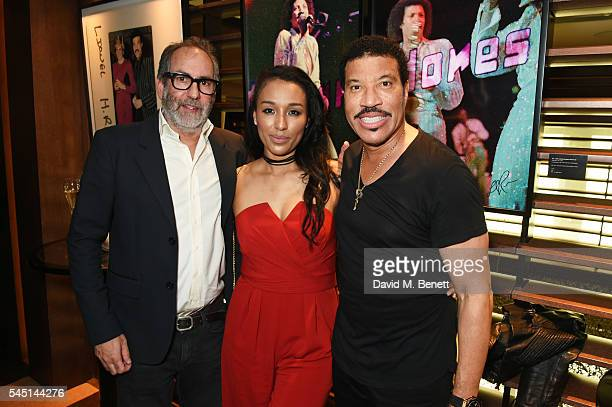 Alan Silfen Lisa Parigi and Lionel Richie attend the exclusive Lionel Richie exhibition 'STILL' by US photographer Alan Silfen at Dorchester...