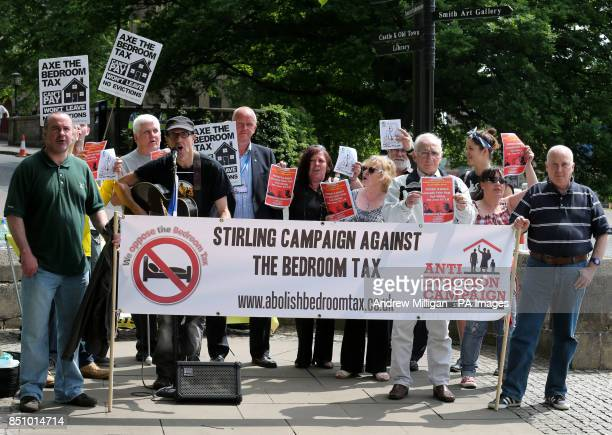 Alan Smart performs with his guitar with anti bedroom tax protesters outside the Albert Halls in Stirling on the first day of the Scottish...